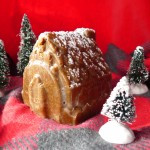 Gingerbread coconut butter shaped into a gingerbread house sprinkled with powdered sugar