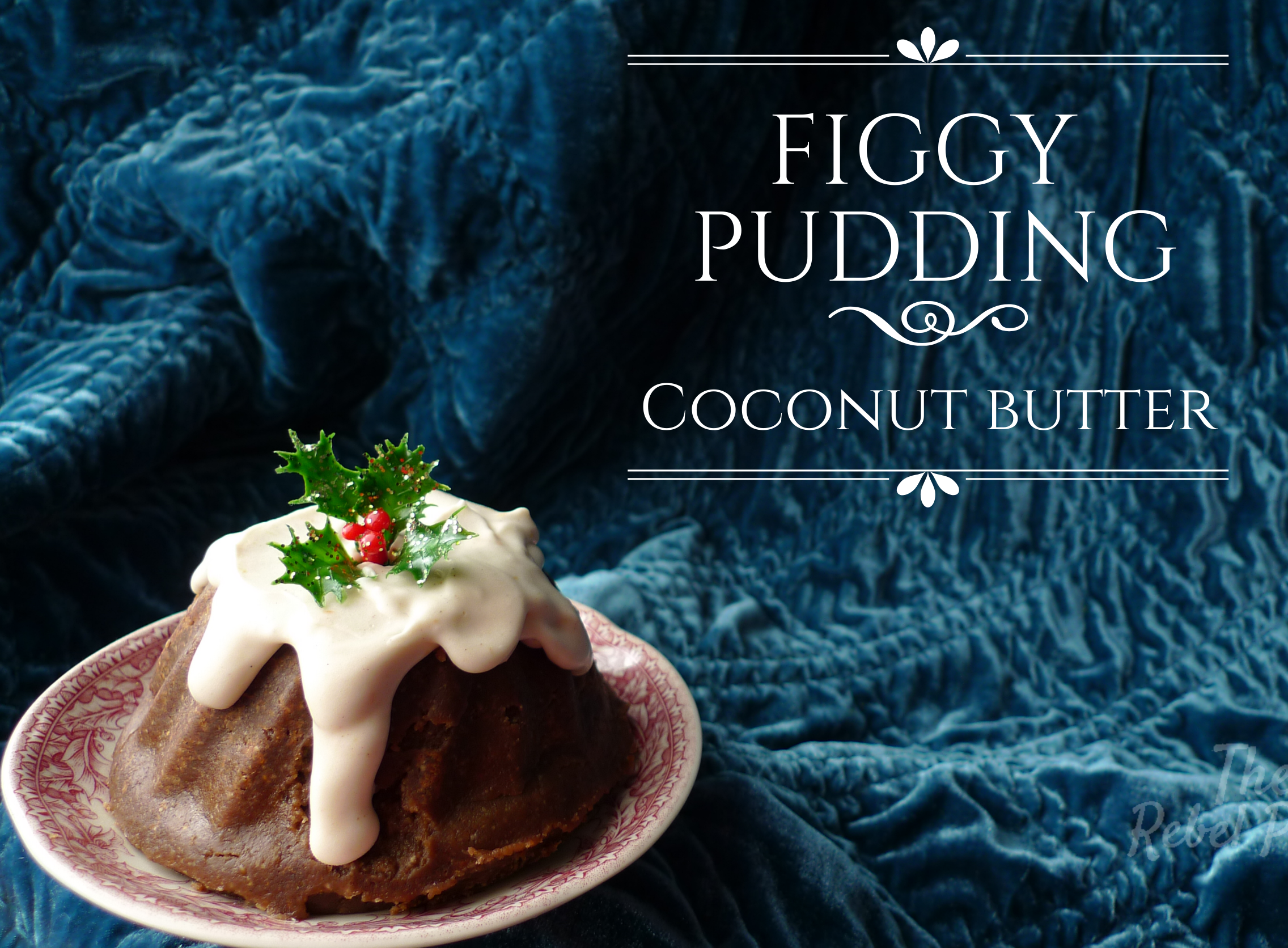 Figgy pudding coconut butter on an ornate plate, topped with coconut cream and a sprig of holly